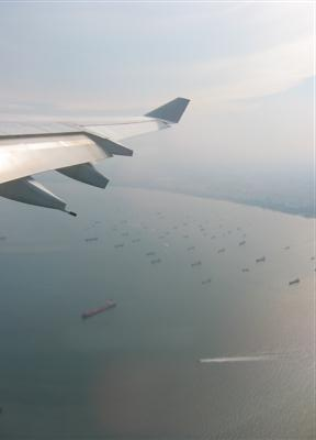 Plane Leaving on My Plane Leaving Changi Airport  Flying Above The Rows Of Ships